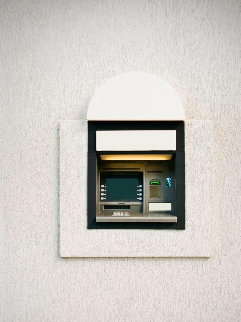 A close-up of an ATM machine.